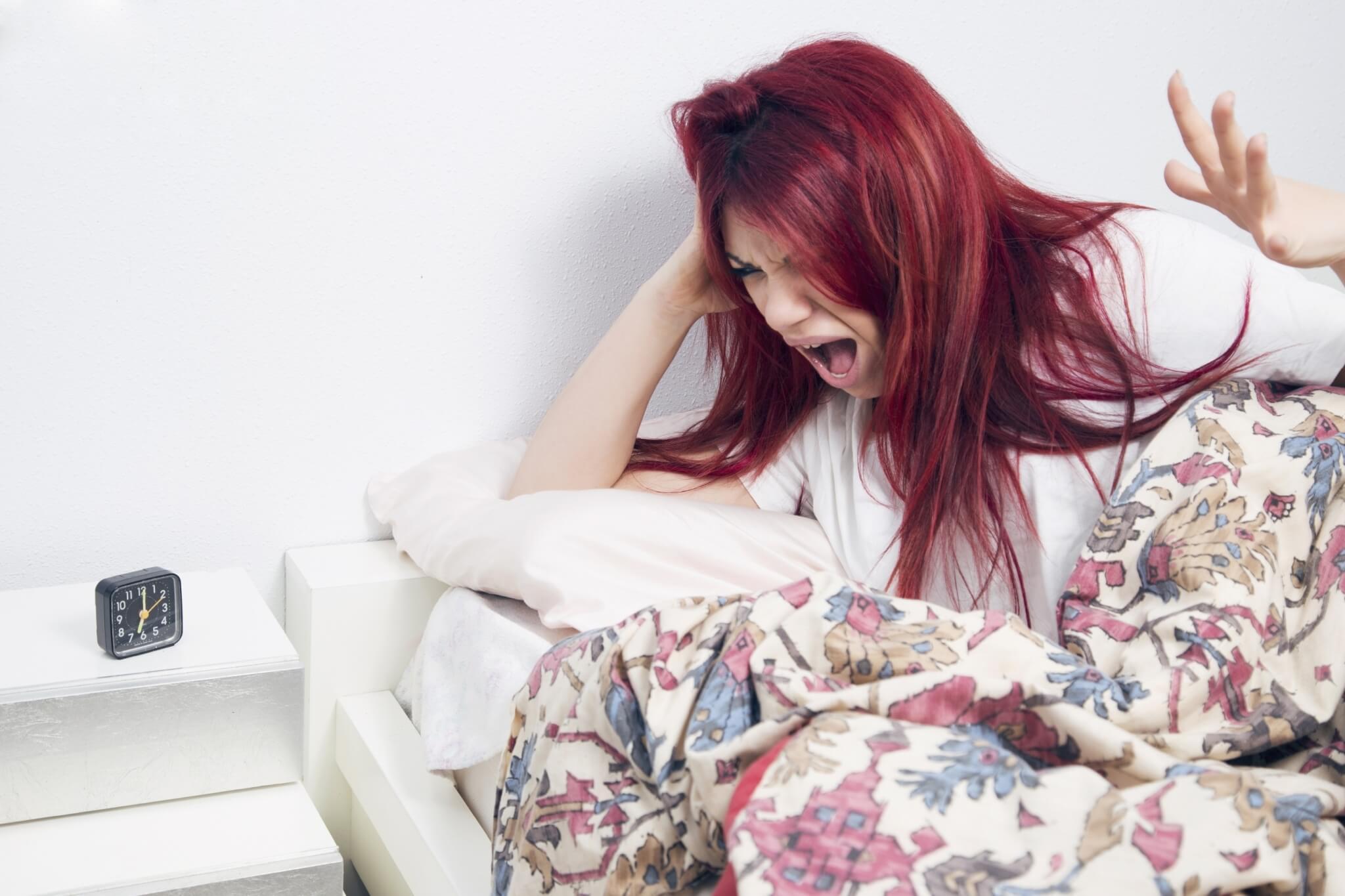 Angry-woman-waking-up-lying-on-the-bed-awake-000088092593_Large.jpg.jpeg