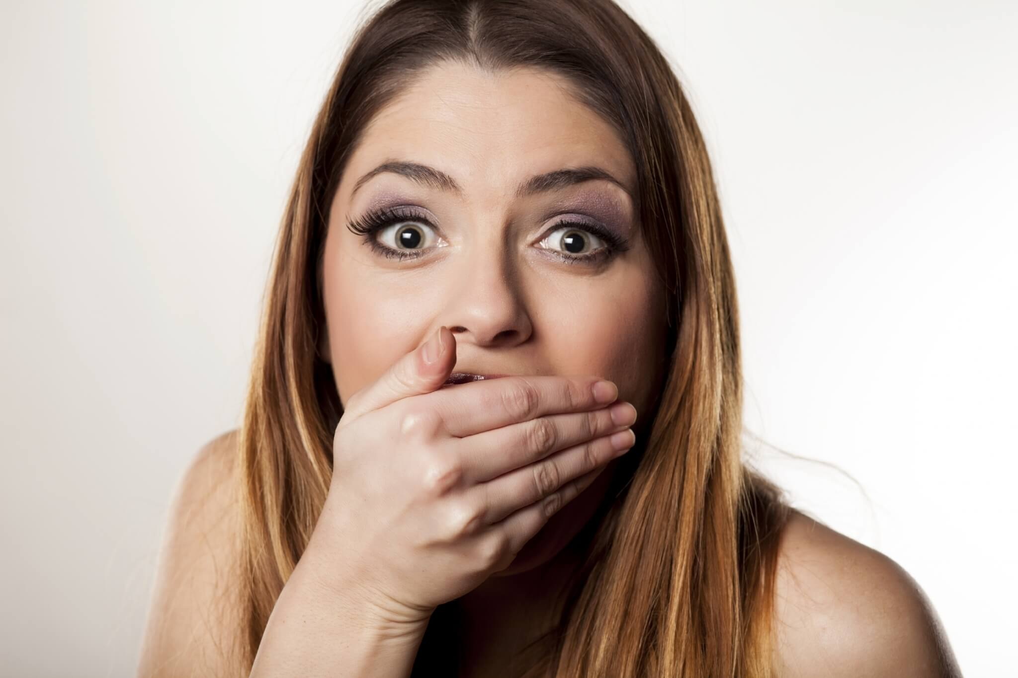 Ashamed-young-woman-covering-her-mouth-with-her-hand-000059843836_Large-1.jpg.jpeg