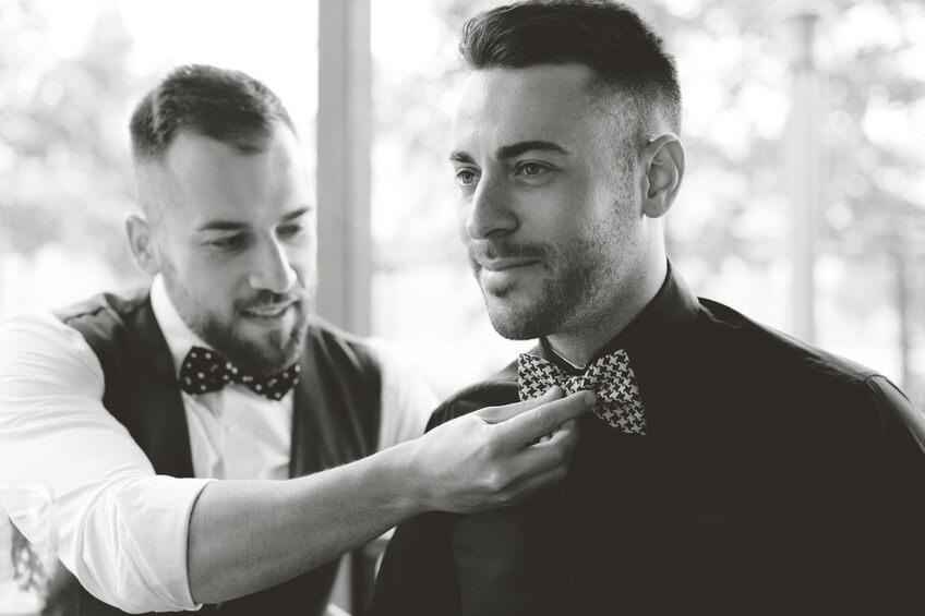 Best-man-fixing-groom-s-bow-tie-000063809937_Small.jpg.jpeg