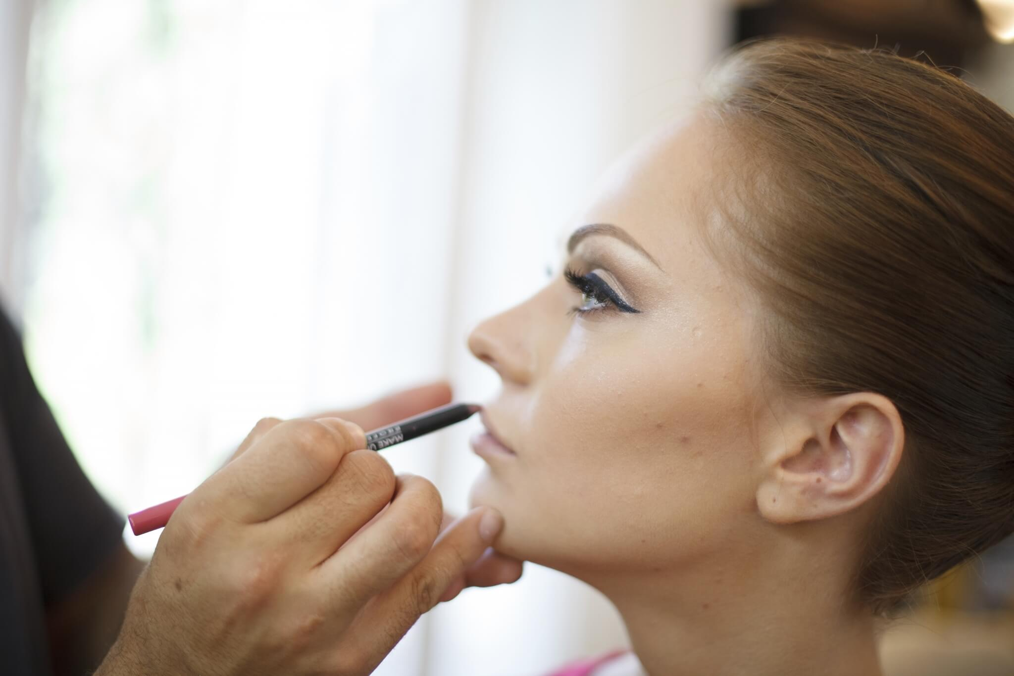 Bride-with-makeup-artist-000053234332_XXXLarge.jpg.jpeg