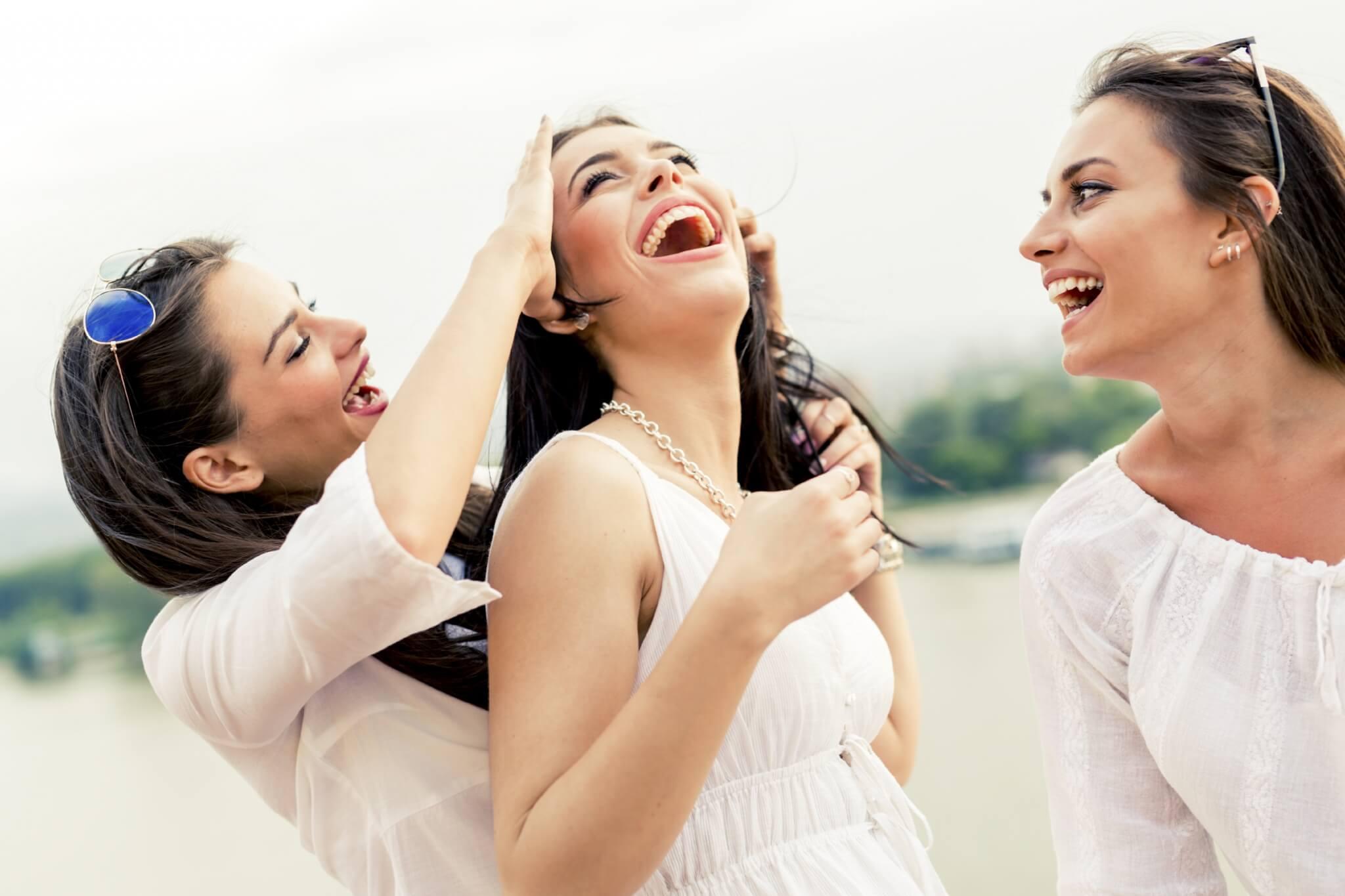 Cheerful-women-having-fun-outdoors-000072923775_Large.jpg.jpeg