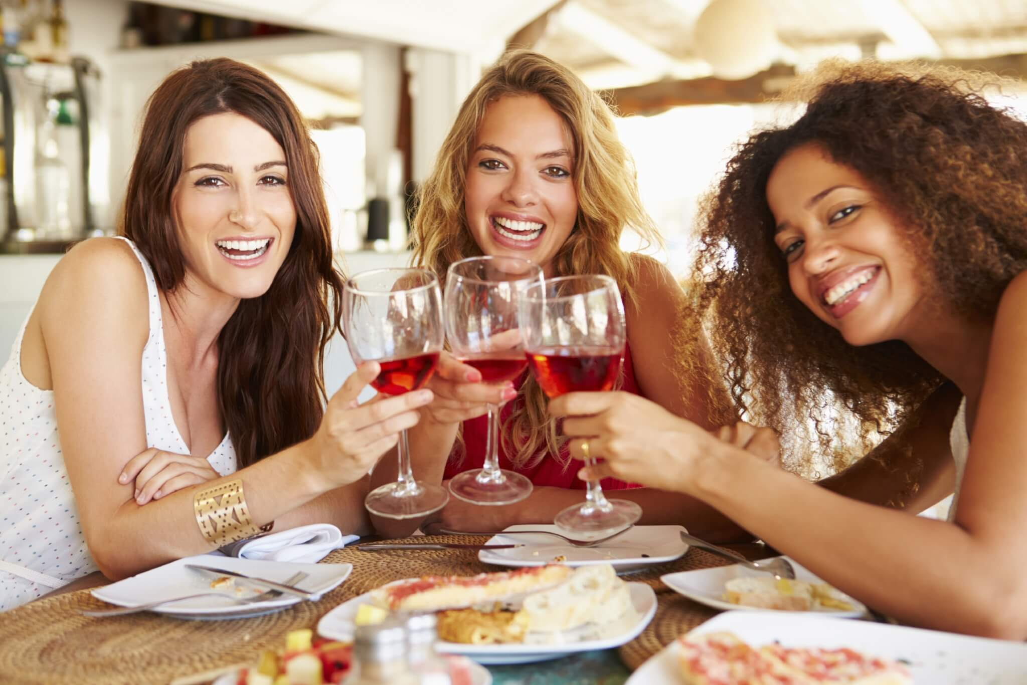Group-Of-Female-Friends-Enjoying-Meal-In-Outdoor-Restaurant-000049767328_Large-1.jpg.jpeg