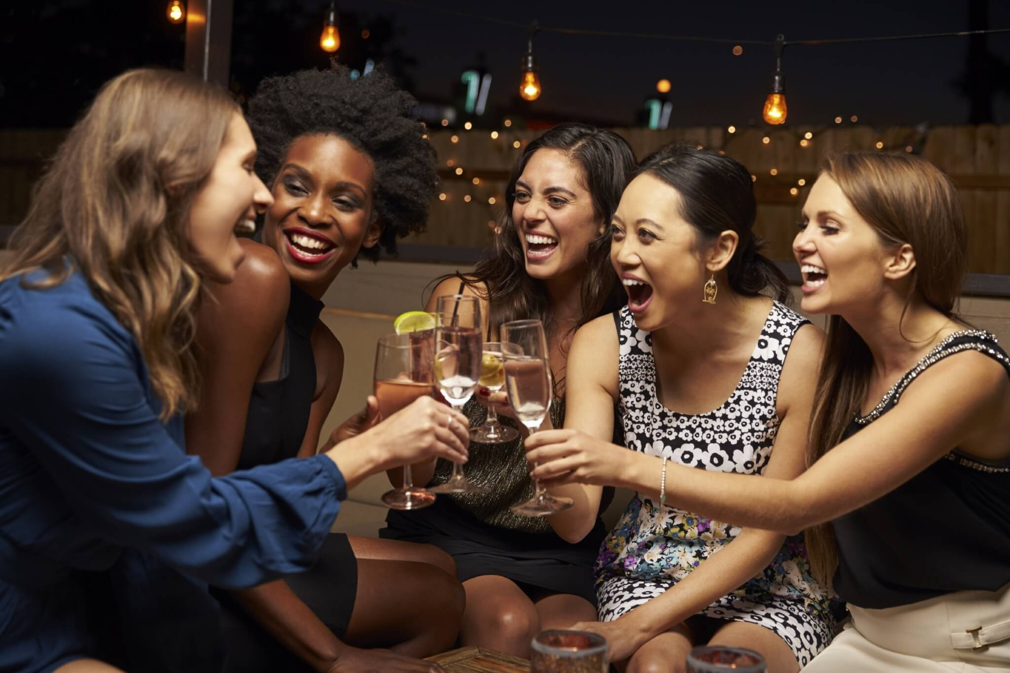 Group-Of-Female-Friends-Enjoying-Night-Out-At-Rooftop-Bar-000083961111_Large.jpg.jpeg