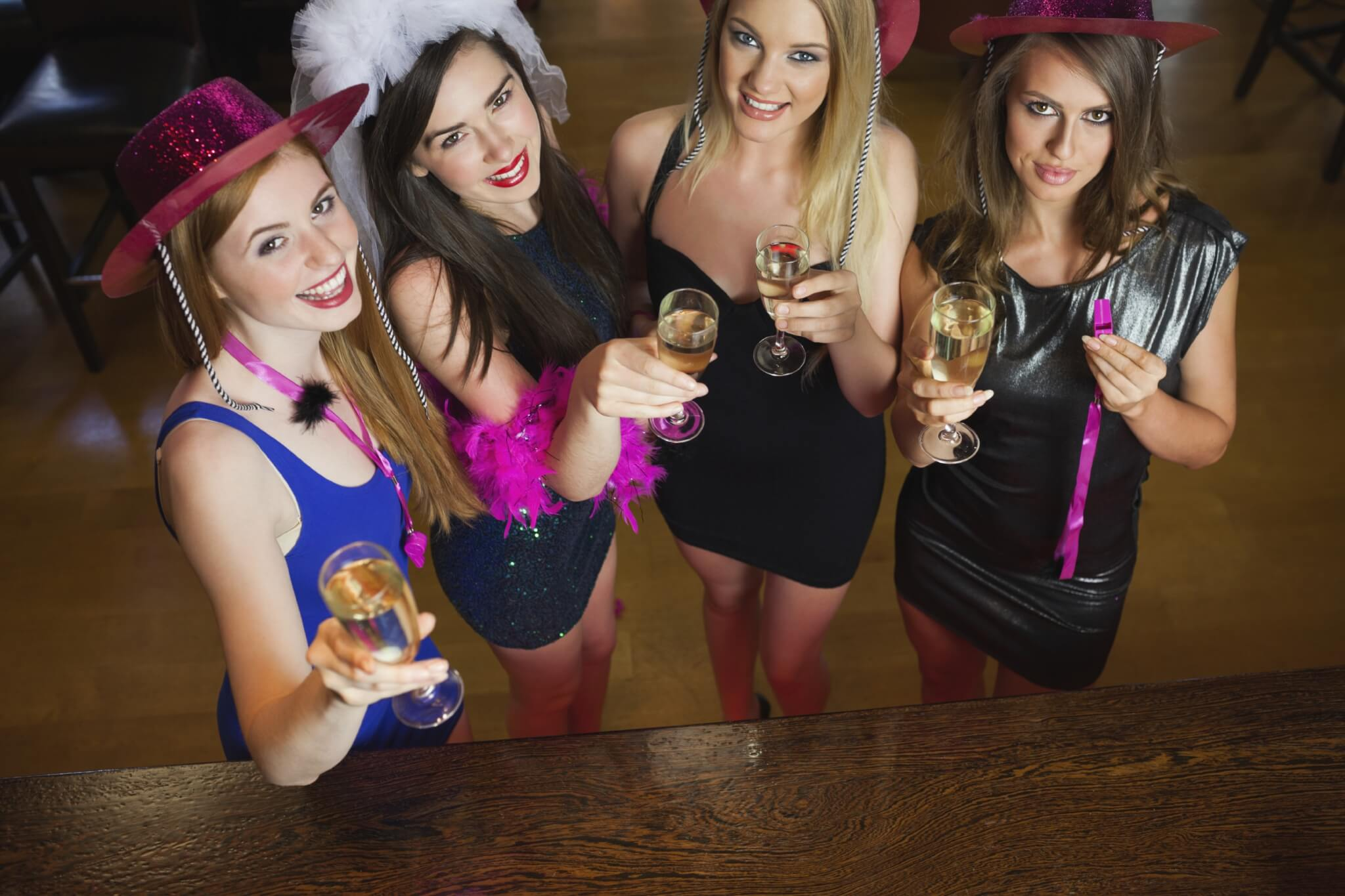 Happy-gorgeous-women-holding-flutes-of-champagne-having-hen-part-000044321098_Large-1.jpg.jpeg