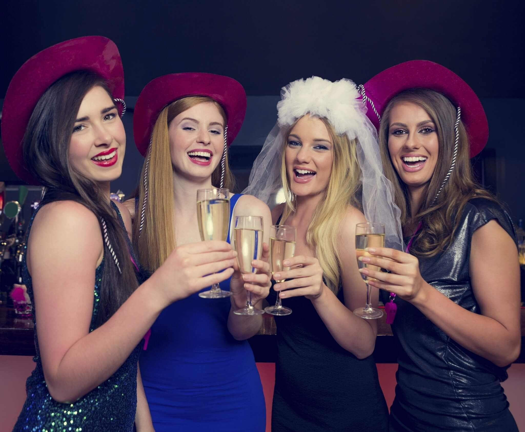 Laughing-friends-clinking-champagne-glasses-at-a-hen-night-000044751376_Double-1.jpg.jpeg