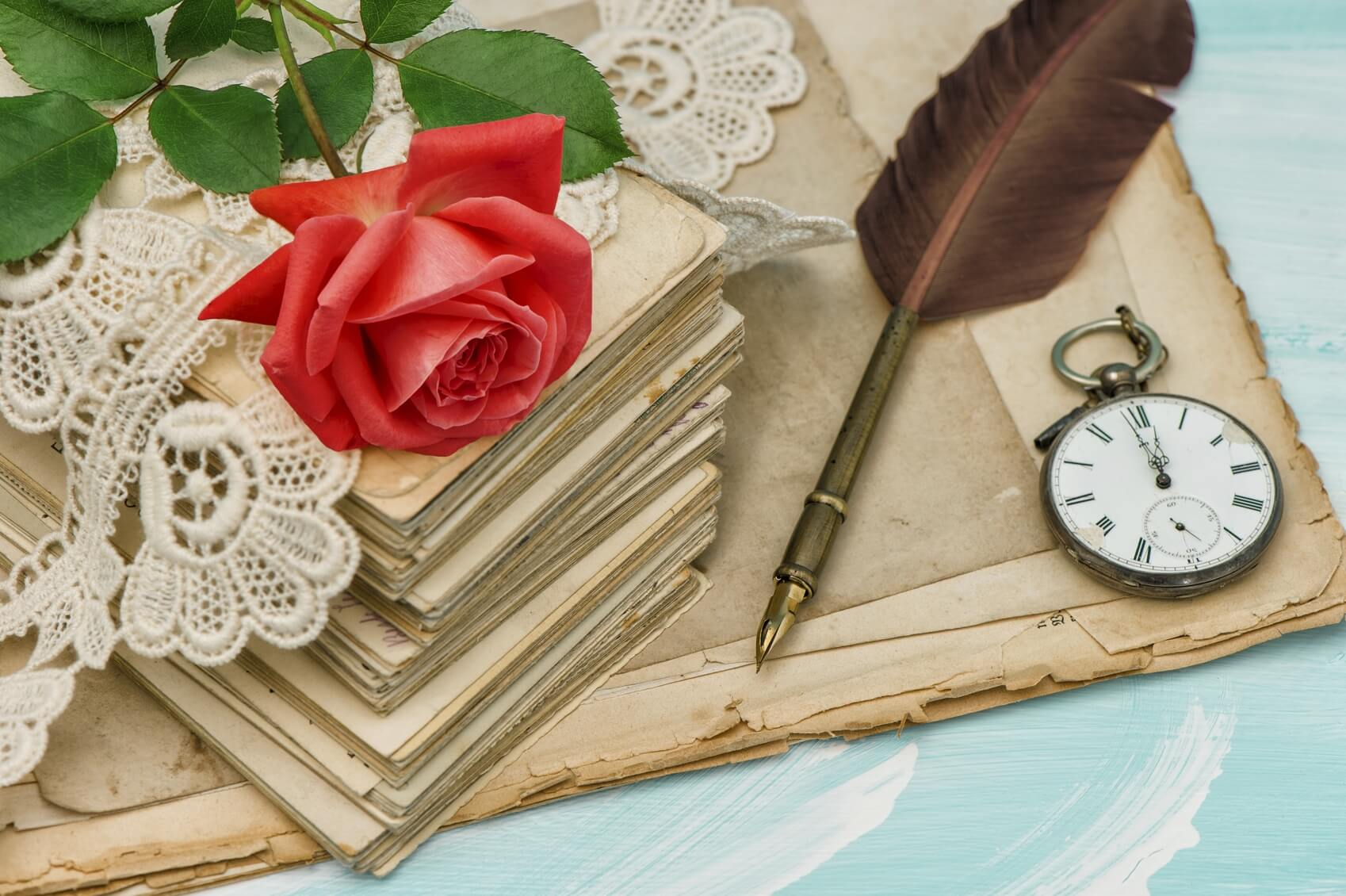 Old-love-letters-lace-and-red-rose-flower-000087174287_Medium.jpg.jpeg