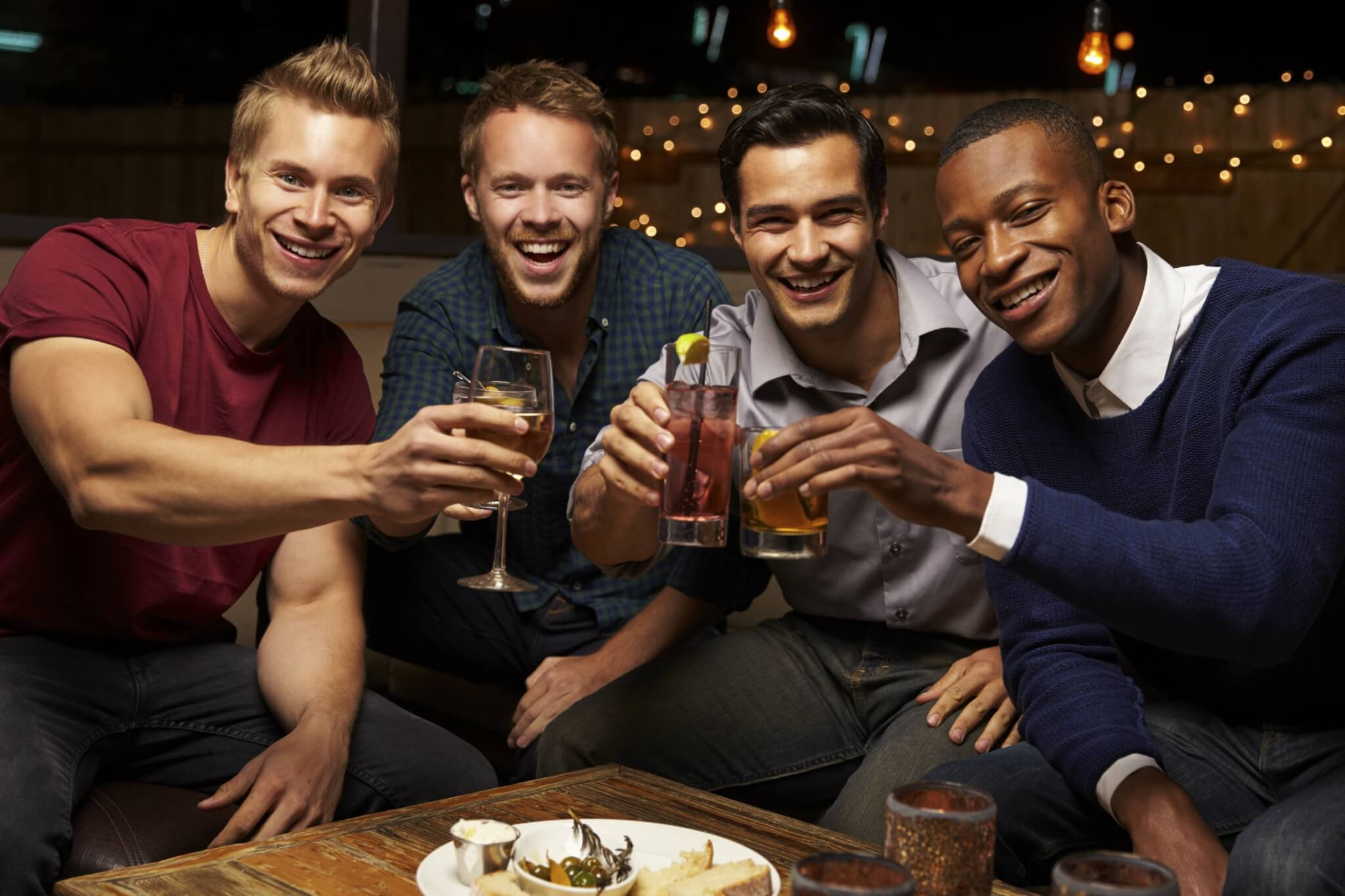 Portrait-Of-Male-Friends-Enjoying-Night-Out-At-Rooftop-Bar-000083961543_Large.jpg.jpeg