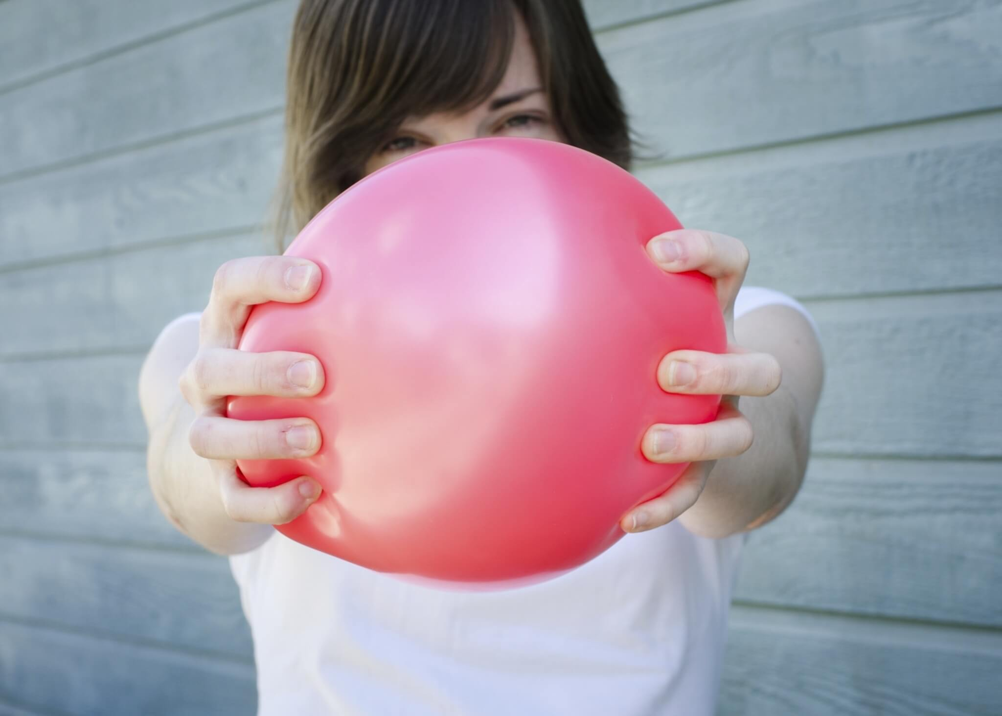 Squeezing-Red-Balloon-000021491116_Medium.jpg.jpeg