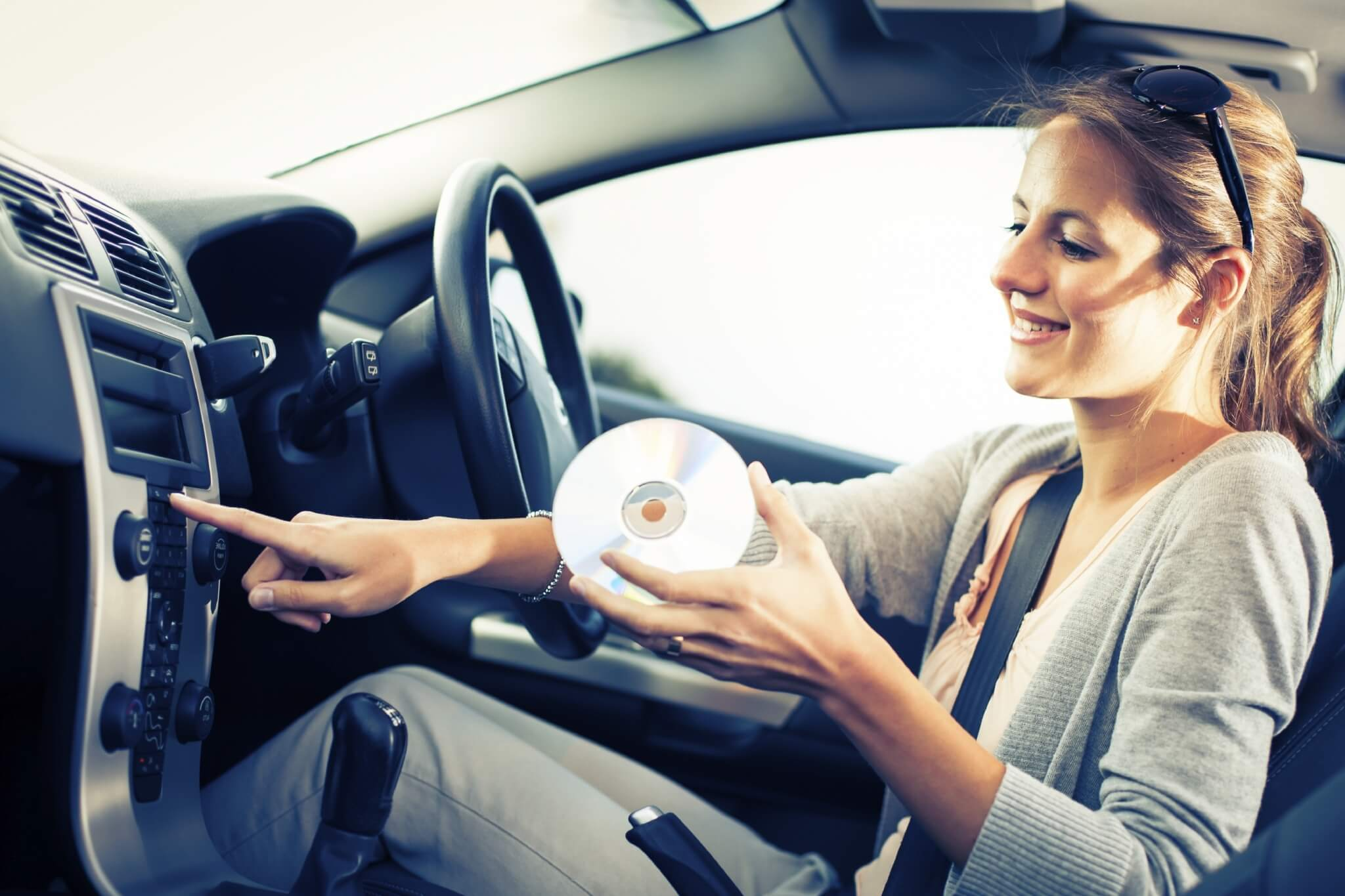 Young-female-driver-playing-music-in-the-car-000070272949_Large.jpg.jpeg