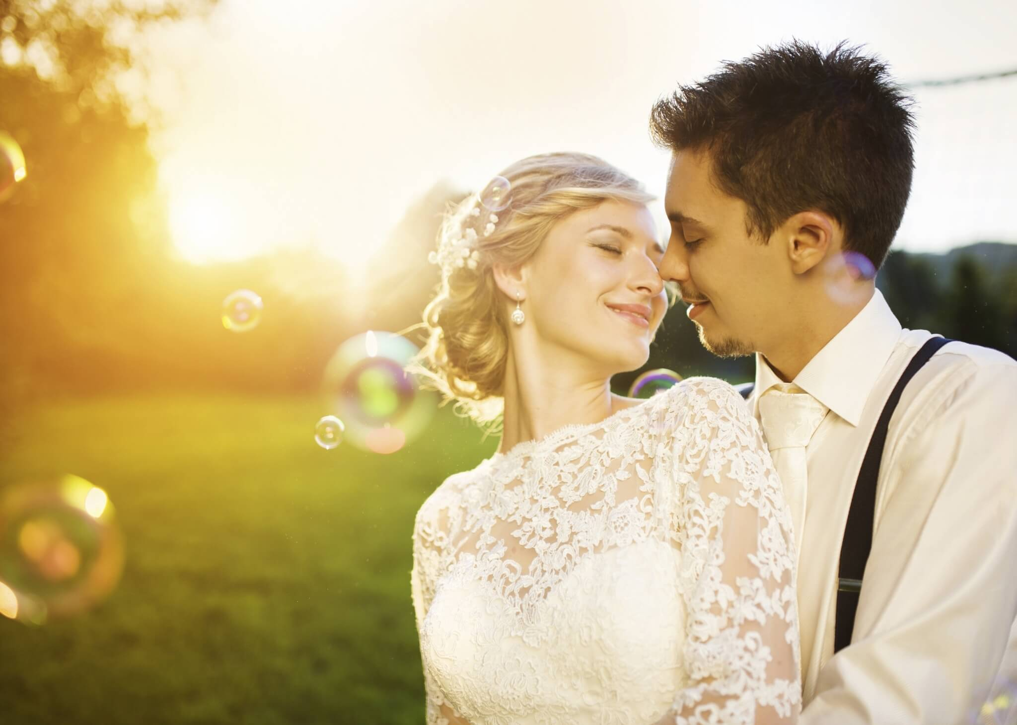 Young-wedding-couple-on-a-summer-meadow-000056962578_Large.jpg.jpeg