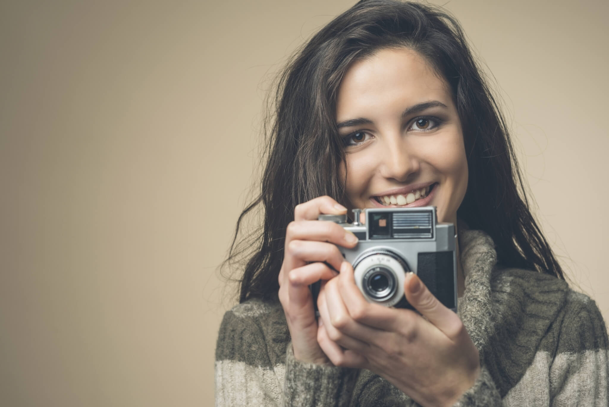 Young-woman-with-vintage-camera-000072402461_Large-1.jpg.jpeg