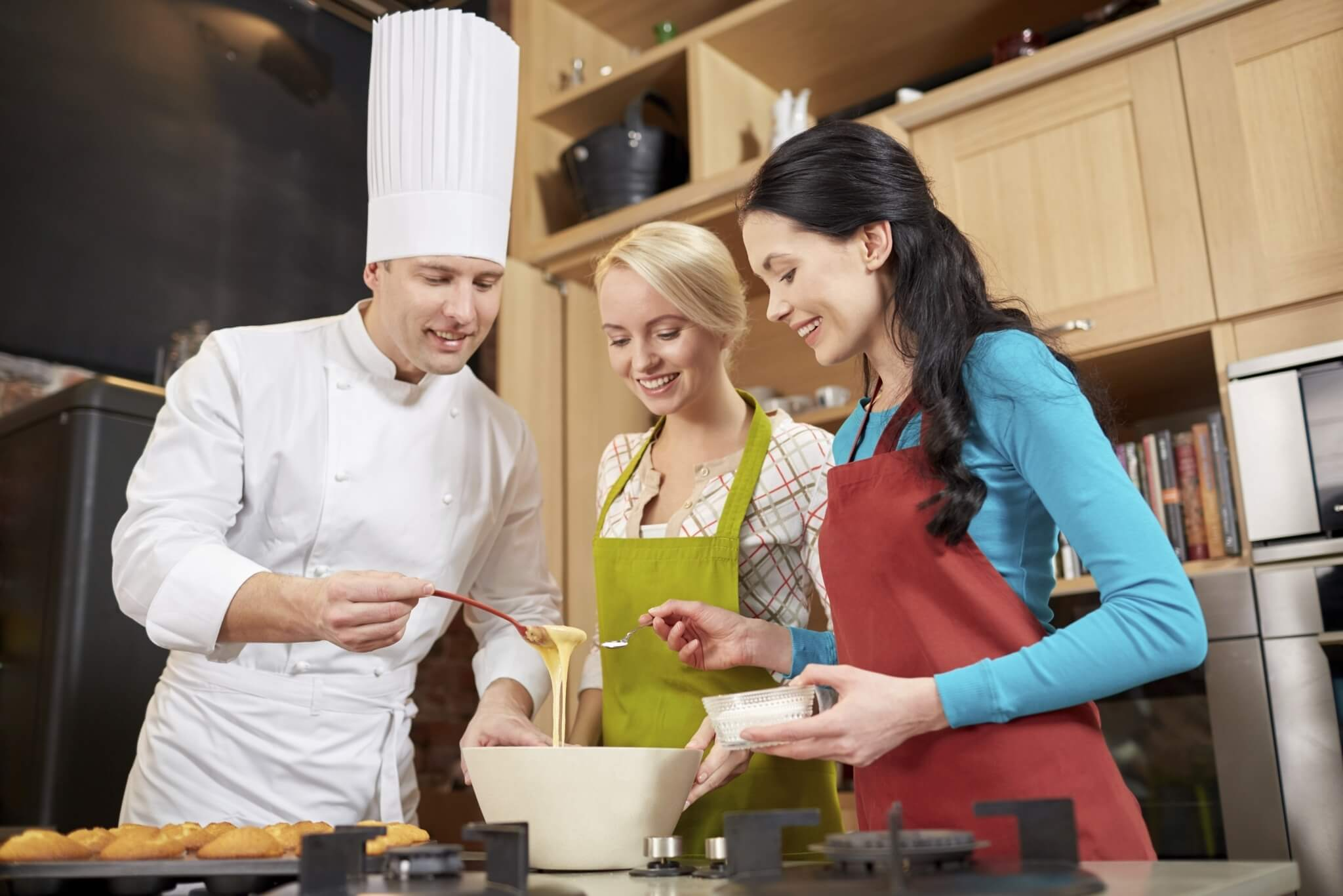happy-women-and-chef-cook-baking-in-kitchen-000070772171_Full.jpg.jpeg